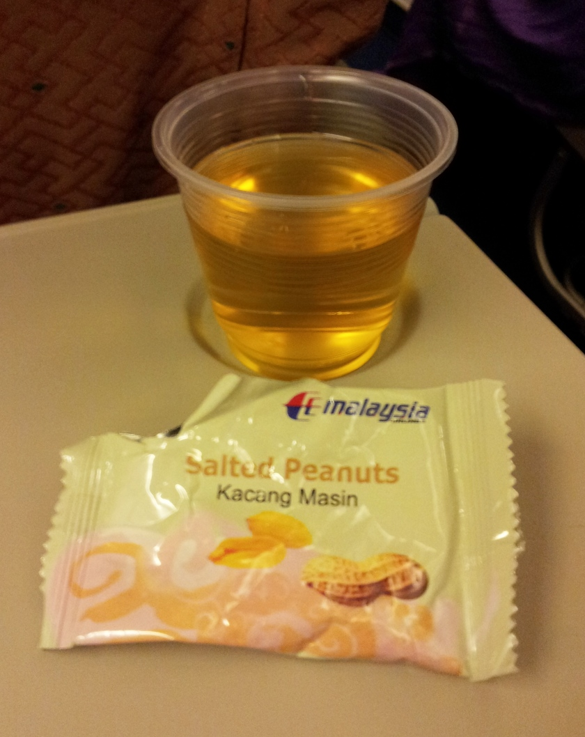 Enjoying some apple juice and peanuts on board
